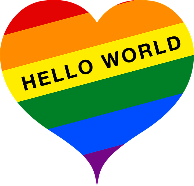 "A logo depicting a rainbow heart with the text ""Hello World"" written across it"